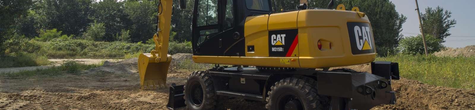 Máy đào bánh lốp Cat